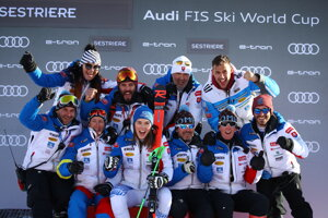 Slovakia's Petra Vlhová celebrates with teammates at the end of an alpine ski, World Cup women's giant slalom in Sestriere, Italy.
