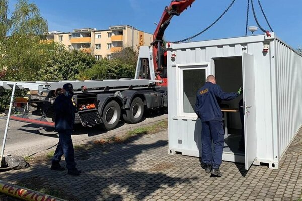 Police brought a container to serve as interrogation room near the retirement home in Pezinok.