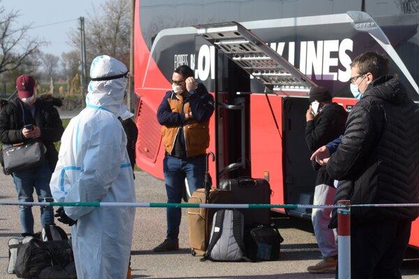Slovak repatriates get off a bus at a state-run quarantine centre in Gabčíkovo, southern Slovakia, on April 2, 2020.