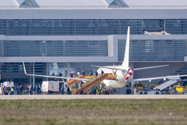 Slovaks get off a plane from Stockholm, Sweden, which landed at Bratislava airport on March 29, 2020.