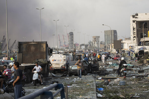 People evacuate wounded after of a massive explosion in Beirut, Lebanon, on August 4, 2020.