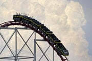 People maintain social distance as they ride a roller coaster at Worlds of Fun amusement park in Kansas City.