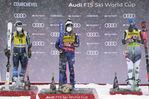Italy's Marta Bassino (center), winner of an alpine ski, women's World Cup giant slalom, stands on the podium flanked by second placed Sweden's Sara Hector (l) and third placed Slovakia's Petra Vlhová, in Courchevel, France.