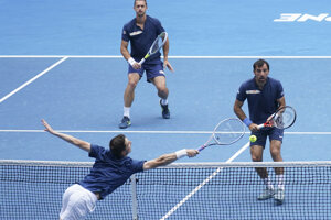 Croatia's Ivan Dodig, right, and Slovakia's Filip Polášek, centre, in action against Rajeev Ram of the US and Britain's Joe Salisbury, bottom left, in the men's doubles final at the Australian Open tennis championship in Melbourne, Australia, Sunday, Feb. 21, 2021.