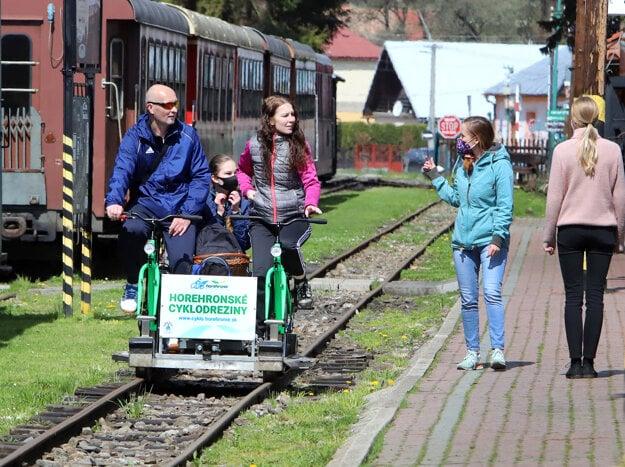 Tourists ride rail bikes on the legendary tracks in Čierny Balog, central Slovakia, on May 16, 2021.