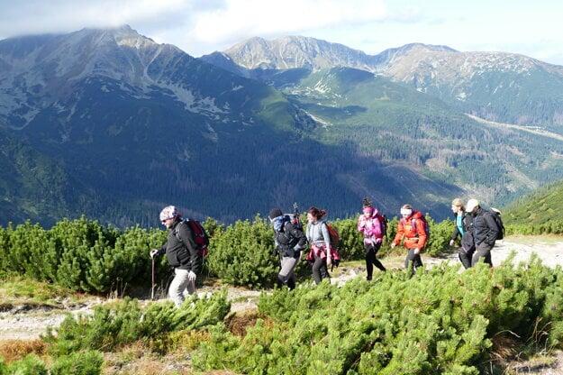 Tourists walk on a hiking trail in the Western Tatras.