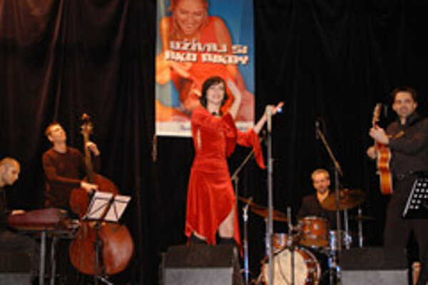 Singer Lucia Lužinská and her band touring schools to teach kids about jazz.