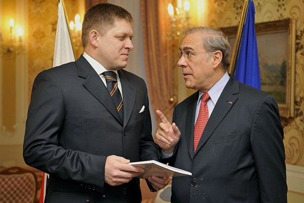 Angelo Gurria of the OECD (right), with PM Robert Fico