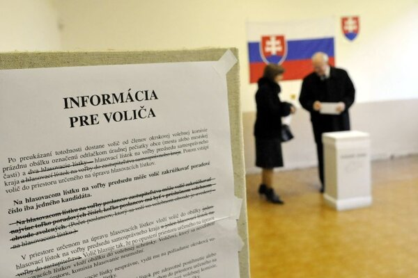 President Ivan Gašparovič and his wife Silvia vote.