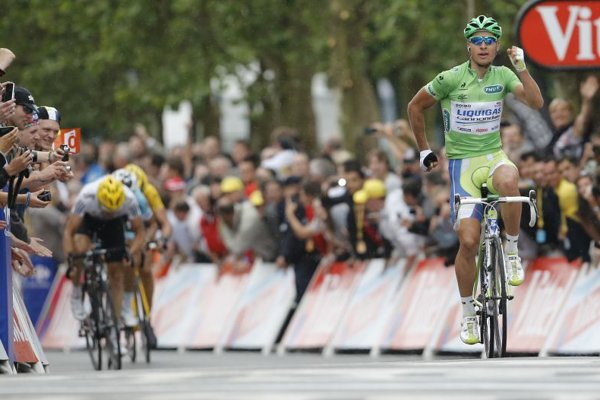Peter Sagan celebrates as he crosses the finish line to win the third stage of the Tour de France on July 3, emulating Tom Hanks' iconic scene as Forrest Gump.