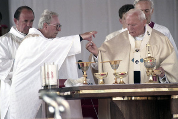 Korec (2L) aids Pope John Paul II during a holy mass in the Slovak town of Levoča.
