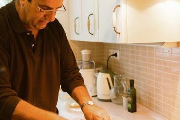 Marios Kountourides, the Cypriot ambassador to Slovakia, preparing Cypriot meals with his wife Sandrine.