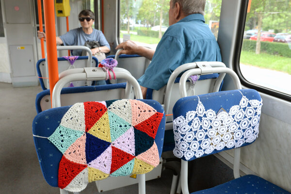 Tram with colourful crochet rugs