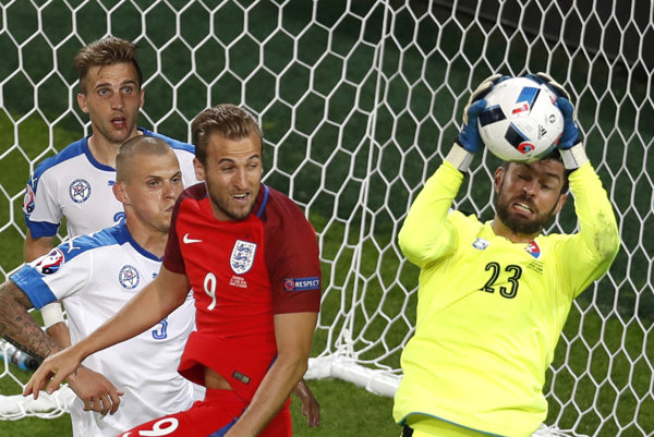 Slovakia goalkeeper Matúš Kozáčik holds the ball next to England's Harry Kane during the Euro 2016 Group B soccer match between Slovakia and England at the Geoffroy Guichard stadium in Saint-Etienne on June 20.