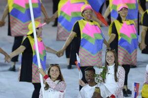 Shooter Dank barteková bears the Slovak flag at the opening cermeony of the Rio Olympics, August 5.