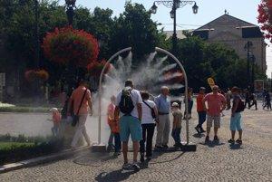 People enjoy the misting system at Hviezdoslavovo square.