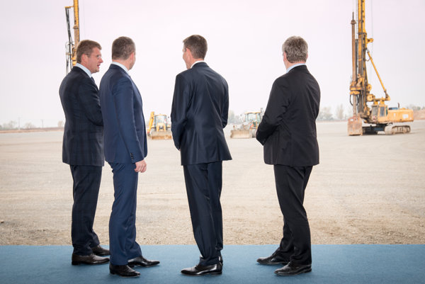 Representatives of the Slovak cabinet and the investor watching the building site of teh new logistics centre of Volkswagen Slovakia.