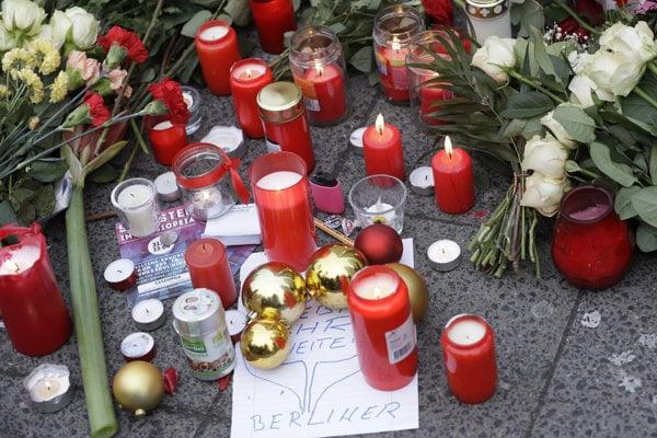 Candles burn near the crime scene in Berlin, Germany.
