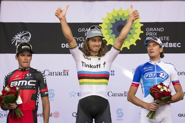 Peter Sagan, center, of Slovakia, raises his hands as he celebrates his win at the UCI Pro Tour cycling Grand Prix in Quebec City in September 2016.