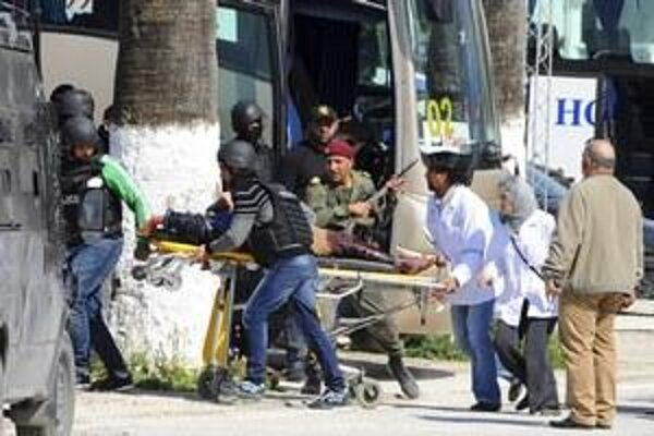 Police help people after terrorist attack in Tunisia