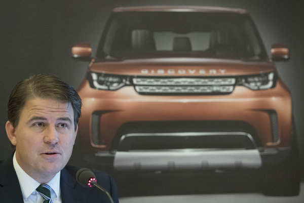 Alexander Wortberg, operations director of JLR Slovakia in front of the poster with the model Land Rover Discovery.