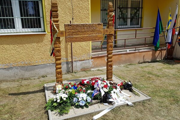Wooden memorial that was crafted by a Roma woodcarver to mark Roma Holocaust Memorial Day.