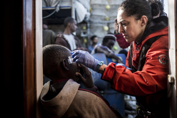 A migrant receives medical assistance after being rescued.