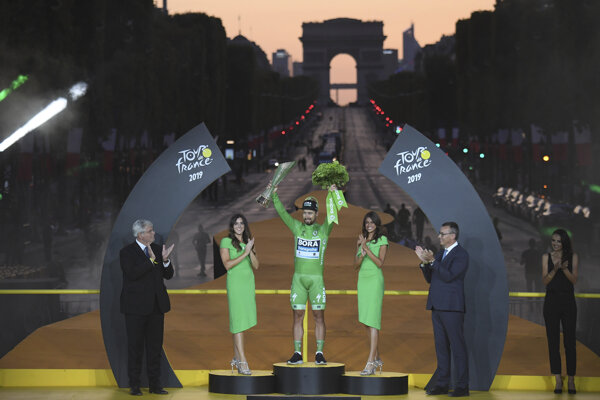 Slovakia's Peter Sagan, wearing the best sprinter's green jersey, stands on the podium after the Tour de France cycling race in Paris, France, on July 28, 2019.