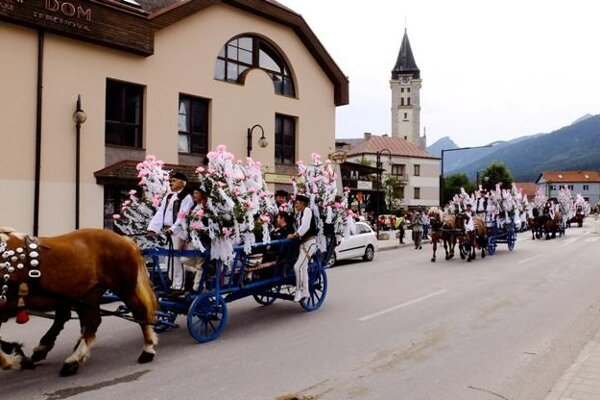 Horse wagon parade during Jánošík Days in Terchová