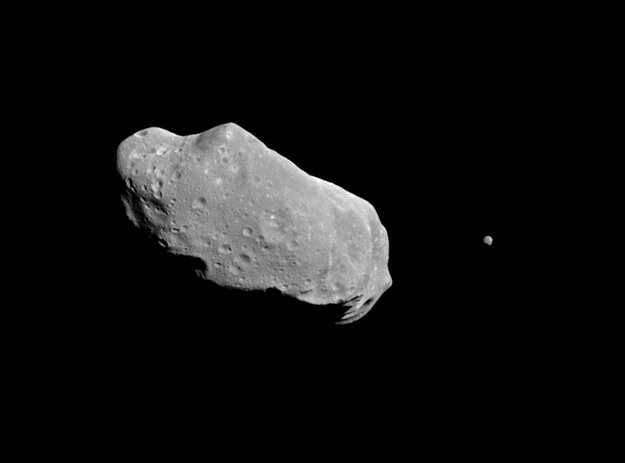 A picture showing both asteroid 243 Ida and its newly discovered moon. Ida, the large object, is about 56 kilometres long. Ida's natural satellite is the small object to the right.