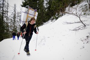 In the image from February 2013, the mountain porter Rastislav Koriščák carries a new washing machine on his back to the Zamkovský Mountain Hut in the High Tatras.