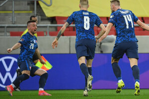 Slovakia's players Róbert Mak (l), and Ondrej Duda (centre) celebrate after Slovakia's Milan Škriniar (r) scored the opening goal during the World Cup 2022 group H qualifying soccer match between Slovakia and Russia in Trnava.