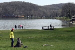 People relax by the lake in Vinné, eastern Slovakia.