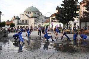 Dancers perform in the streets of Trenčín, spotlighting the architecture of the city.