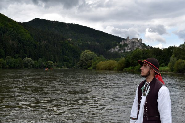 Strečno resident Ivan, 21, works as a rafter from April to October. He has been doing this job for six years. Strečno Castle can be seen in the background.