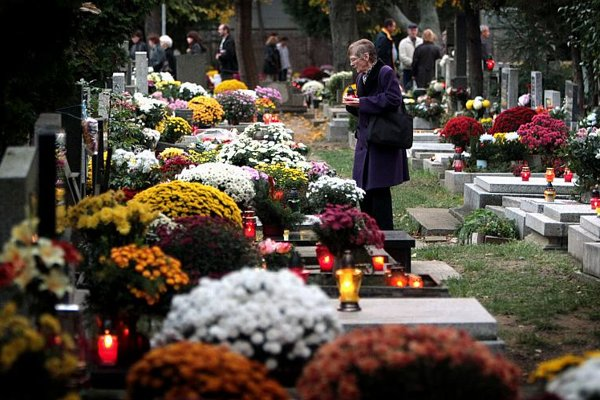 Slovaks mark All Saints' Day by lighting candles and laying flowers on loved ones' graves.