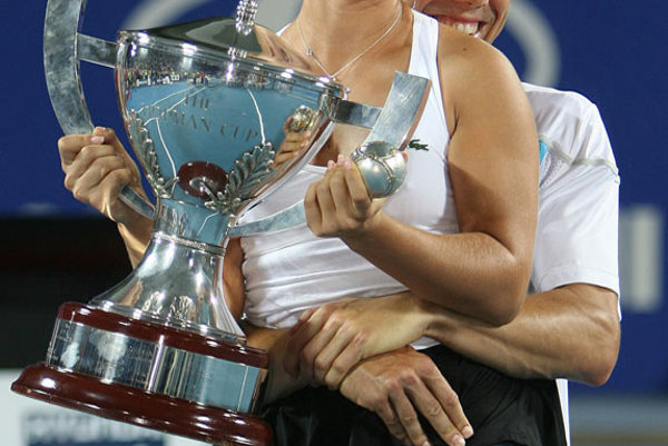 Dominika Cibulková and Dominik Hrbatý celebrate their unexpected victory in the final of tennis's Hopman Cup.