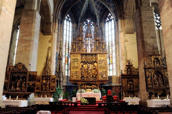 The main altar of the Church of St. Jacob, the highest gothic altar in the world, is made of linden wood without any nails and it's 18.52 metres high.