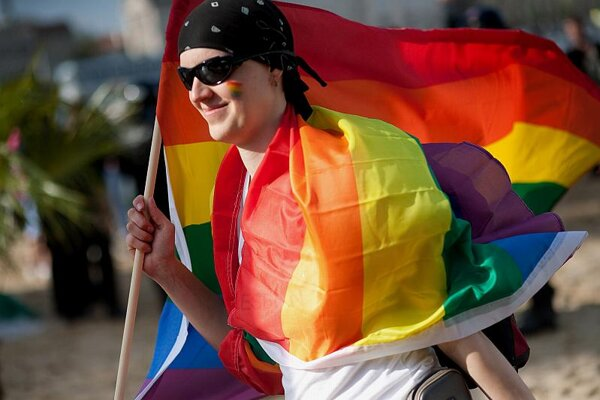 A Gay Pride marcher flies the rainbow flag in Bratislava on Saturday, May 22.