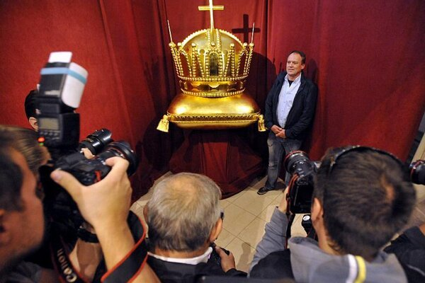 The restored crown went on display before being returned to its spire towering over Bratislava.