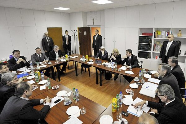 The 12-member Coalition Council meets frequently to decide on government policy.
