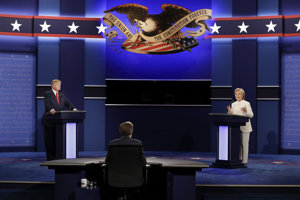 Democratic presidential nominee Hillary Clinton answers a question as Republican presidential nominee Donald Trump listens during the third presidential debate at UNLV in Las Vegas on October 19.