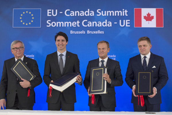 CETA singing, L-R:President of the European Commission Jean-Claude Juncker, Canadian Prime Minister Justin Trudeau, President of the European Council Donald Tusk, and Slovak Prime Minister Robert Fico, October 30, 2016