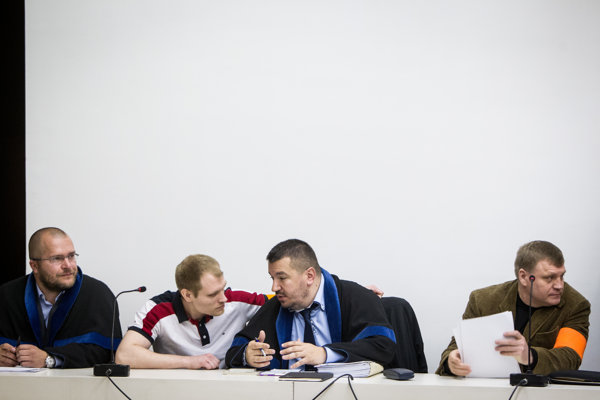 Sergey and Alexander Salmanov and their lawyers in April 2015