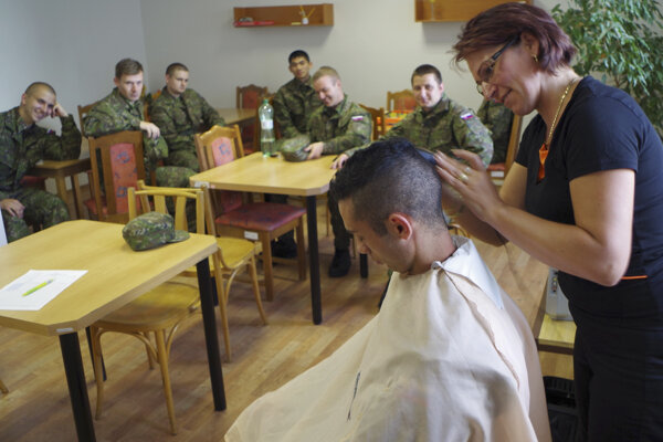 Cutting of hairs prior to starting voluntary military training.