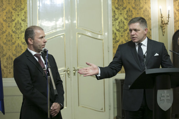 New anti-corruption fighter Peter Kovařík (L) introduced by Prime Minister Robert Fico.