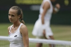 Slovakia's Magdalena Rybarikova walks away after losing a point to Spain's Garbine Muguruza during their Women's Singles semifinal match on day nine at the Wimbledon Tennis Championships.