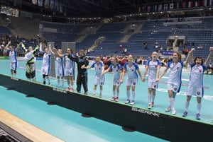 Slovak team rejoices after beating Latvians at World Championship in Bratislava, December 9.