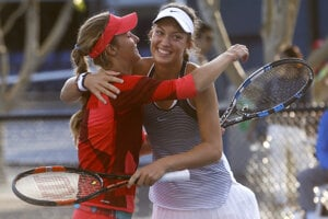 Slovak Mihalíková (R) with Russian Kalinska after their victory in doubles'finals at Australian Open.