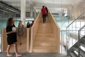 Wooden bridges interconnecting individual office spaces.